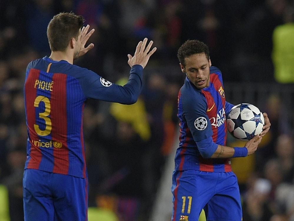 Pique (l.) wollte Neymar (r.) zurück zu Barca locken